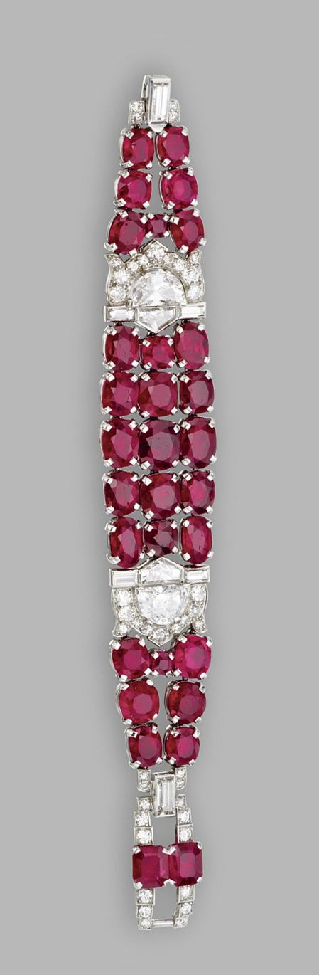 RUBY AND DIAMOND BRACELET, CARTIER, CIRCA 1925  Estimate: 200,000 - 300,000 USD   LOT SOLD. 590,500 USD  (Hammer Price with Buyer's Premium)  Cushion-shaped and oval rubies weighing a total of approximately 62.00 carats, accented by half-moon-shaped, round, single-cut, baguette and epaulette-cut diamonds weighing a total of approximately 9.60 carats, mounted in platinum, length 6 inches, signed Cartier, numbered 7223.