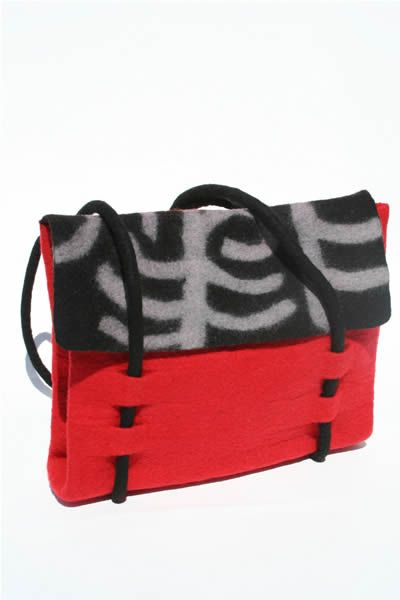 Felt bag (red). - This felt handbag is handmade using traditional felted wool by artisan craftswomen in Central Asia. In cheerful red with black and grey detailing, this bag combines traditional Shirdak patterns with a contemporary design.