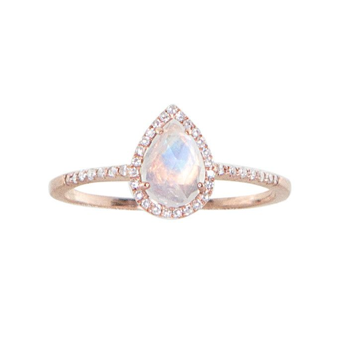14kt gold and diamond single band teardrop moonstone ring  $1,020.00