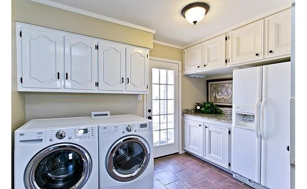Great laundry room with cabinetry!