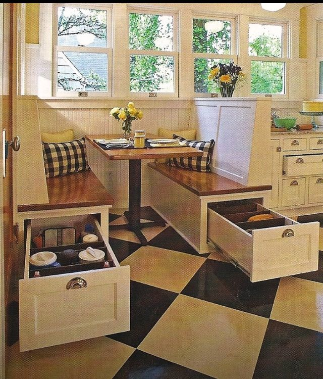Built-in-bankette with storage underneath. Slide out drawers for large infrequently-used kitchen appliances, serving ware, dishes, etc.
