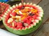 Watermelon Fruit Basket:  Combining a variety of fruits in a hollowed-out watermelon shell makes a grand display and a delicious addition to brunch.