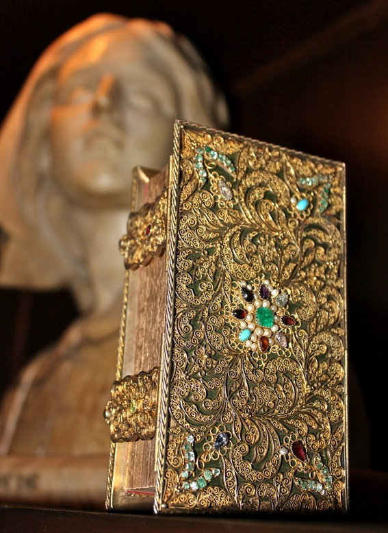 I like old books. Here's one of the most ornate I've ever found. THE CONFESSIONS OF ST. AUGUSTINE.  Printed in Paris in 1638 -  bound in a 374 year-old gold-filigree jeweled binding w/ emeralds, rubies, topaz, turquoise, amethyst, garnet, aquamarine, and pearls.