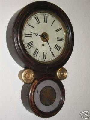 for bid is this very old Ingraham Ionic figure 8, time only, wall clock,this clock is complete with key and pendulum.the size is appx 22 inches tall x appx 14 inches wide.this clock does run great, th