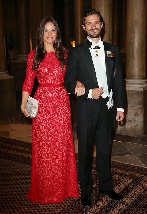 Swedish Prince Carl Philip and fiance Sofia Hellquist wore a ravishing, floor-length lace dress. The lady in red stunned in her embroidered gown.