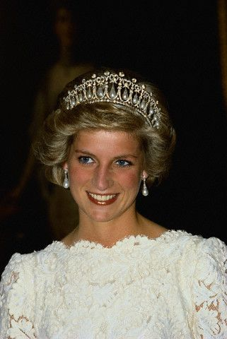Princess Diana Wearing a Tiara and Smiling  She attends a formal event in a lace evening gown and diamond tiara.  November 10, 1985  Washington, DC, USA