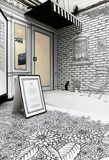 "The art of shop window : A fairy-tale world. Monochromatic and ink line style, Illustrations fill the store ""ARTIFACTS"" from window to outside garden."