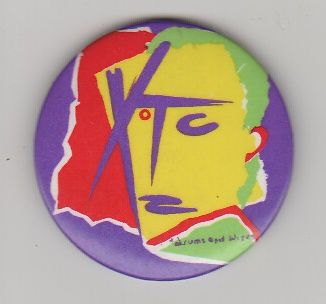 XTC badge.
