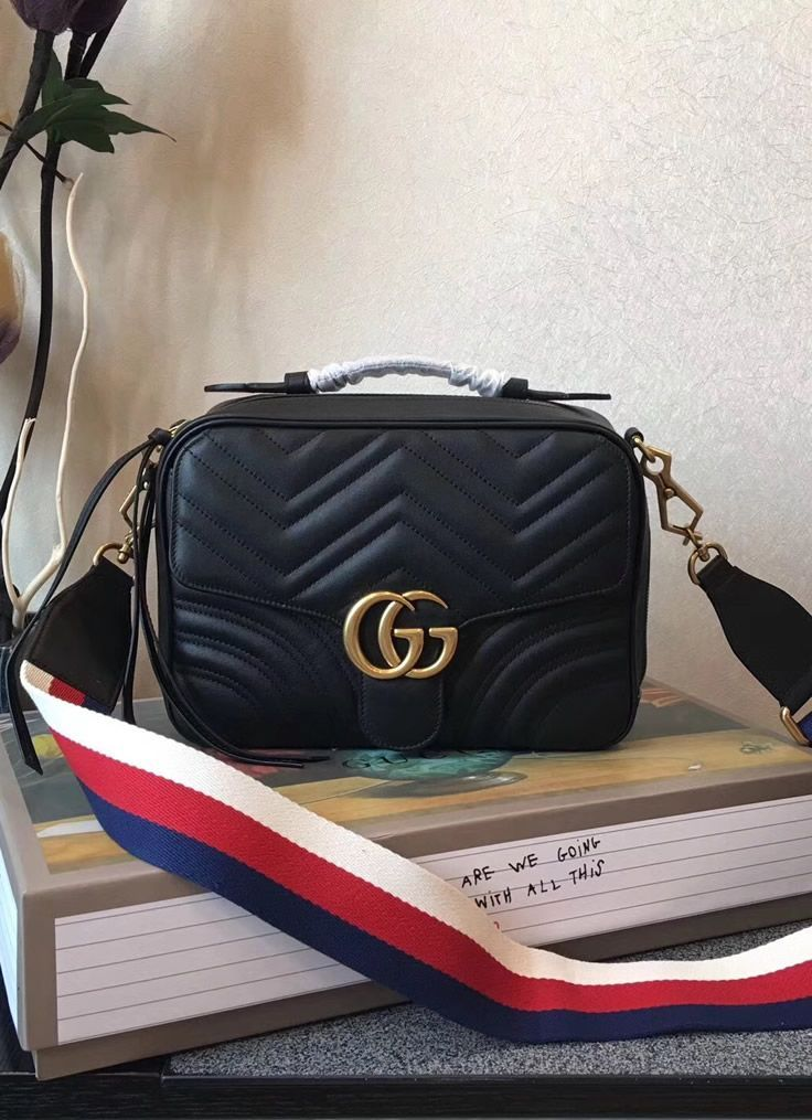 96e53b17fc54 The shoulder strap of the Gucci GG Marmont small Black shoulder bag is  well-known Sylvie Web stripe. As you can imagine, it looks astonishing.