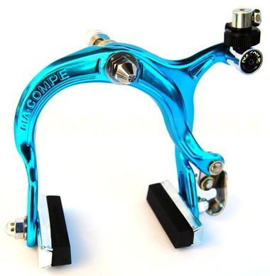 Dia-Compe 883 front BMX brake caliper - brand new production. Features the new retro brake blocks and cone dress up nut on the pivot bolt. Color: BRIGHT DIP BLUE ANODIZED (a turquoise-ish shade of blu
