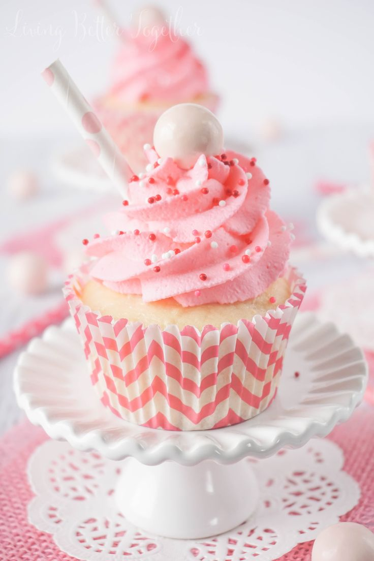 Strawberry Milkshake Cupcakes ~  have a vanilla malt base topped w/ strawberry milk whipped cream frosting, sprinkles, & a whopper