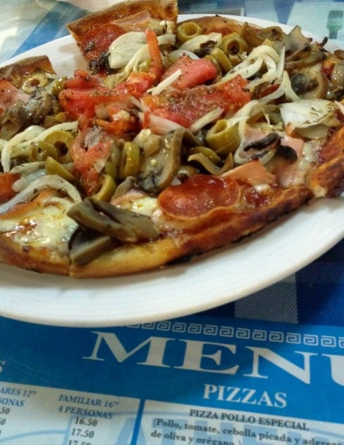 This too.  Pizza Ateniense–Ham, pepperoni, mushrooms, green olives, onions, tomato, garlic, anchovies, oregano, and olive oil. From onevanillabean.com
