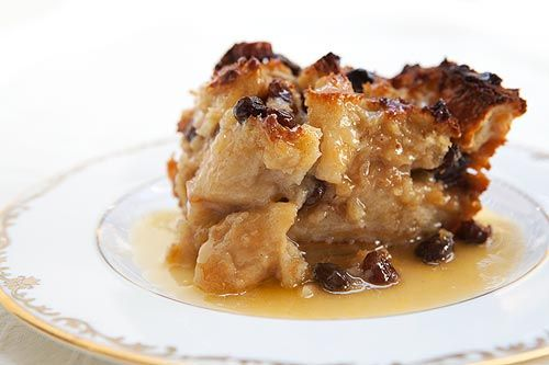 Authentic New Orleans bread pudding with French bread, milk, eggs, sugar, vanilla, spices, and served with a Bourbon sauce.