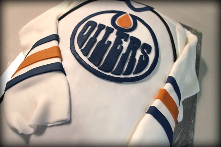 AWESOME. Can I have a half-Oilers, half-TARDIS cake for my next birthday, please??