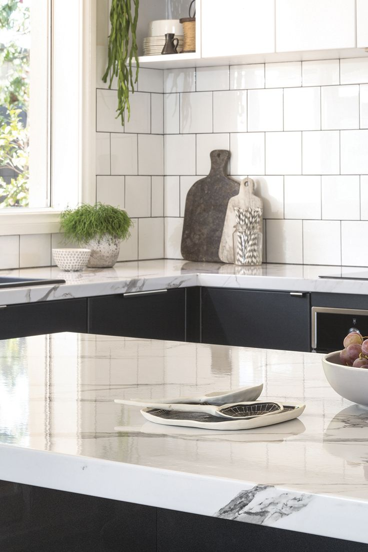 Get the look: Luminess Metallic thermoformed doors and panels with a Calcutta Gloss cut to measure laminate benchtop. For more inspiration visit kaboodle.com.au