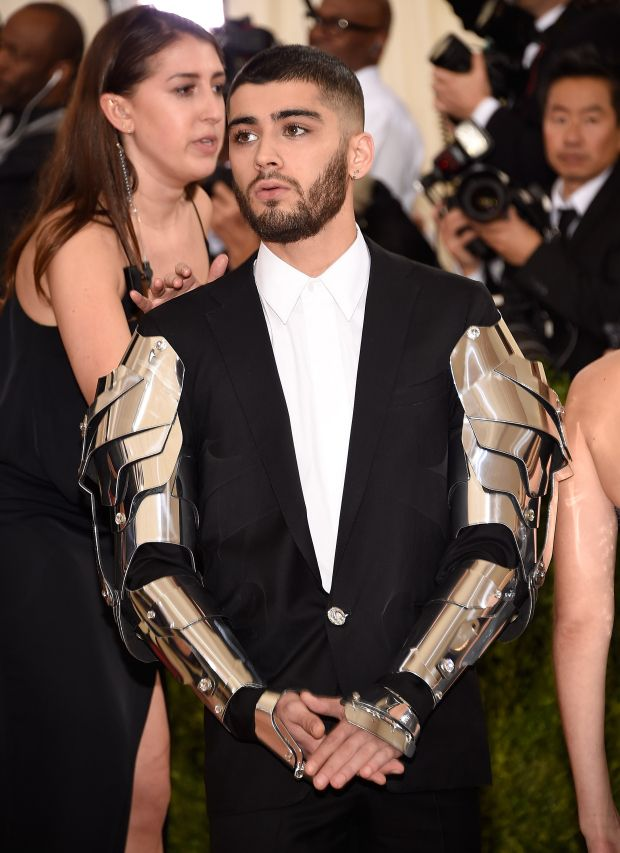 Arms by Versace. Attitude, Zayn's own.