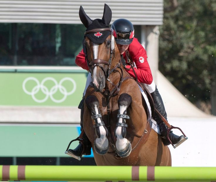 Canada's Eric Lamaze, from Schomberg, Ont., makes a jump with his horse Fine Lady 5 during the equestrian individual jumping final at the 2016 Summer Olympics Friday, August 19, 2016 in Rio de Janeiro, Brazil. Lamaze won the bronze medal. THE CANADIAN PRESS/Ryan Remiorz