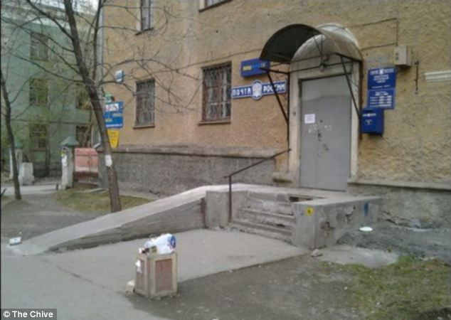 Not a help: A disability ramp leading to the door of a police station is obstructed by a handrail