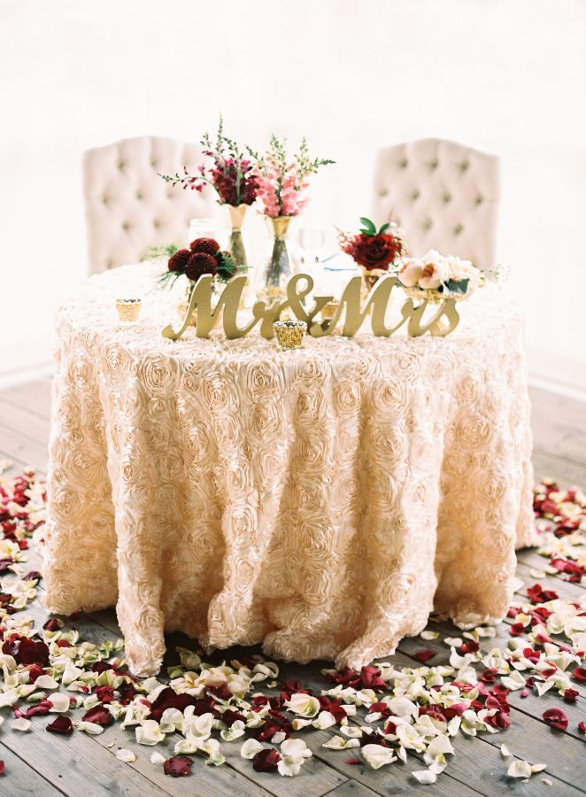 Petal accented sweetheart table: http://www.stylemepretty.com/pennsylvania-weddings/2016/03/14/rustic-meets-luxurious-farm-wedding/   Photography: Joey Kennedy - http://www.joeykennedyphotography.com/
