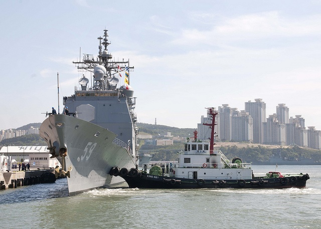 BUSAN, Republic of Korea (May 10, 2013) Harbor tugs assists Ticonderoga-class guided missile cruiser USS Princeton (CG-59) as it arrives in Busan for a scheduled port visit. Princeton is underway on a routine deployment to the western Pacific region. (U.S. Navy photo by Mass Communication Specialist 2nd Class Joshua Bryce Bruns/Released)