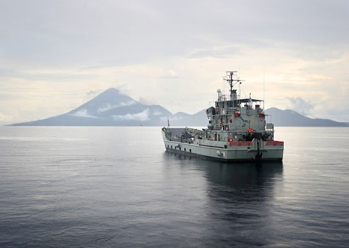 HMAS Labuan at anchor during early morning off Halmahera Island, Maluku. www.sunnyindonesia.com.
