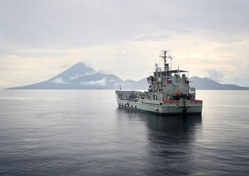 HMAS Labuan at anchor during early morning off Halmahera Island, Maluku. www.sunnyindonesia.com.