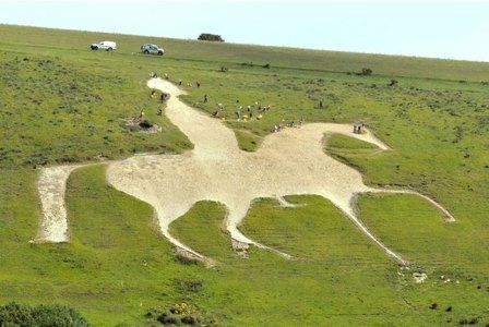 LAND ART:  Osmington White Horse - Weymouth, Dorset, England;  the only chalk horse cut out in England to have a rider – shows King George III on his white charger Adonis;  first cut in 1808;  It is 280 feet long and 323 feet high    ...look closely and you can see people next to the horse...