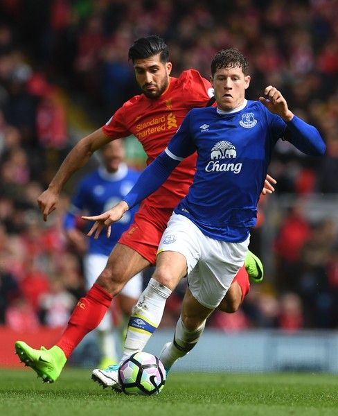 Everton's English midfielder Ross Barkley (R) runs away from Liverpool's German midfielder Emre Can during the English Premier League football match between Liverpool and Everton at Anfield in Liverpool, north west England on April 1, 2017. / AFP PHOTO / Paul ELLIS / RESTRICTED TO EDITORIAL USE. No use with unauthorized audio, video, data, fixture lists, club/league logos or 'live' services. Online in-match use limited to 75 images, no video emulation. No use in betting, games or single…