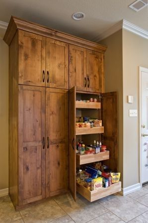 Double pantry on south wall. Pull out shelves. Make the top cabinets the same as the other top cabinets and put glass doors to match the rest of the kitchen.