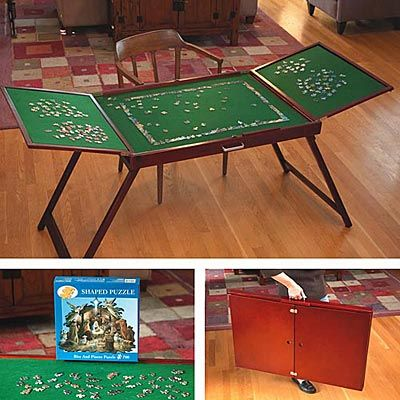 Wondering how hard it would be to make one...you could have a table top version.  Fold-And-Go™ Wooden Jigsaw Puzzle Table