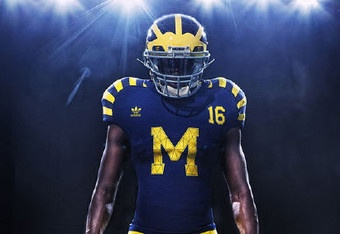 Navy and yellow Michigan uniform, with yellow stripes running across the shoulder.
