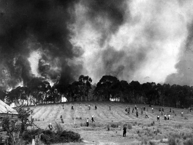 Geoff Bull's Walkley Award winning picture of firefighters against the backdrop of an advancing fire at Panton Hill. 1962