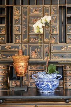 Restraint in accessorizing pays off when furniture -- like this intricate Asian desk -- is already a piece of art. www.oldhouseloves.com/interiors