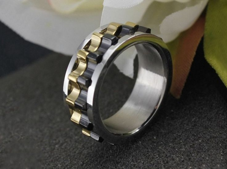 Moveable Gear Steampunk Ring Item Type: Rings Surface Width: 6mm Rings Type: Wedding Bands Metals Type: Stainless Steel Shapepattern: Round Material: 316 Stainless Steel Lead&Nickel: Free Keywords: M