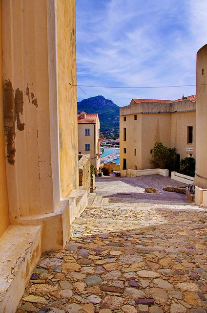Calvi, Haute Corse, France  I'm entranced by the warm colors of the stone and buildings.