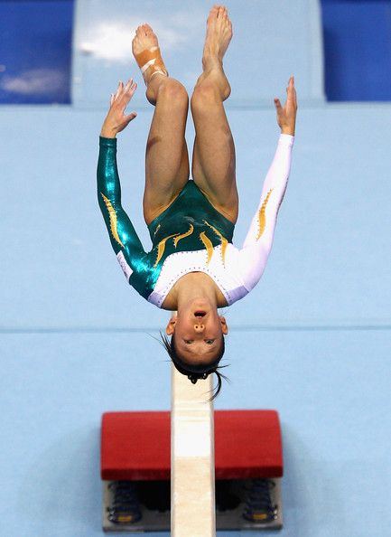 Angela Donald of Australia competes in the balance beam final on day eight of the Singapore 2010 Youth Olympics at Bishan Sports Hall on Aug...