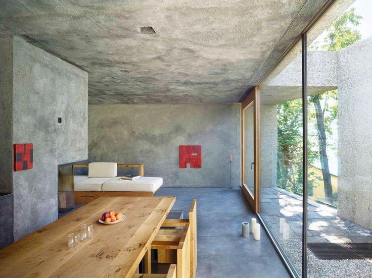 Tiny Concrete Bunker Opens to a 3-Story Home Filled With Light - http://freshome.com/tiny-concrete-bunker-opens-to-3-story-home/