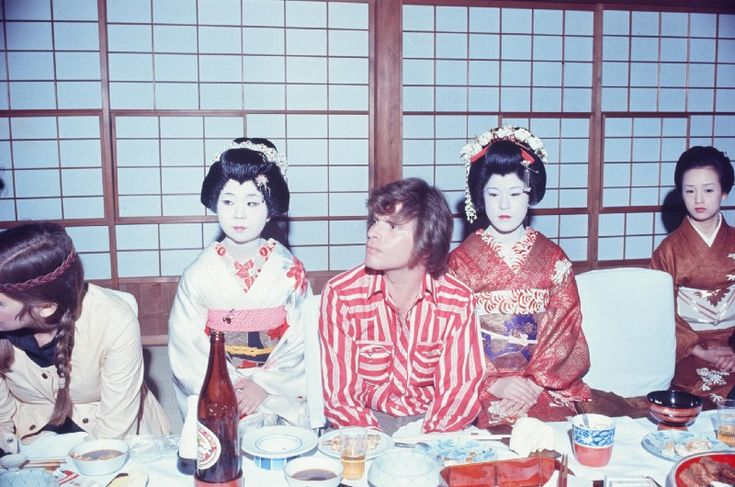 John Fogerty & Creedence Clearwater Revival, at a Tokyo Geisha dinner in 1972. These bizarre photos show the world's biggest rock stars as tourists in 1970s Japan