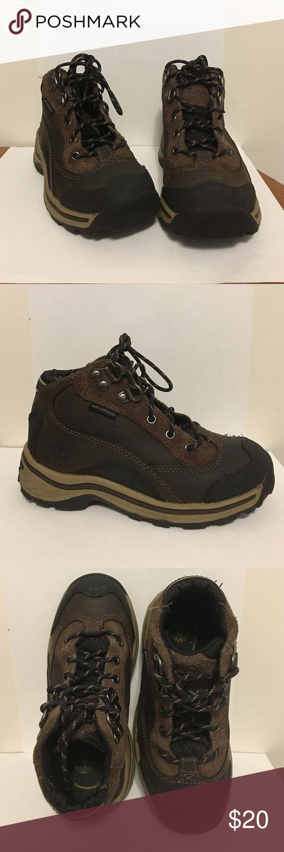 Timberland Kids Boots Good condition, Timberland boots for boys. Dark brown and tan waterproof. They were worn before but they are still in good condition.  Size 10.5 Timberland Shoes Boots