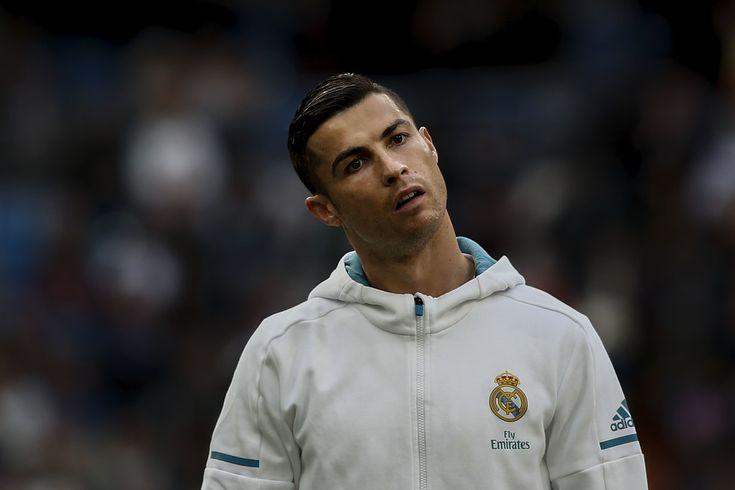 Cristiano Ronaldo Photos - Cristiano Ronaldo of Real Madrid CF gestures prior to start the La Liga match between Real Madrid CF and Sevilla FC at Estadio Santiago Bernabeu on December 9, 2017 in Madrid, Spain . (Photo by Gonzalo Arroyo Moreno/Getty Images)<i></i>* Local Caption <i></i>* Cristiano Ronaldo - Real Madrid v Sevilla - La Liga