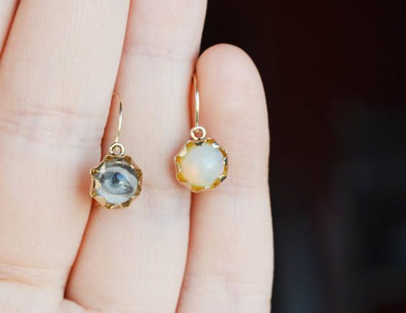 This is a cute mismatched stone 14k yellow gold earring with victorian style flower setting and front closure. Vintage market find, I dont know if the earring is antique or just vintage from the last century. One of the stones is a natural opal with pale blue-white hue and yellow glow -