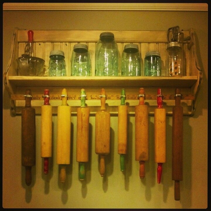 Vintage kitchen decor / rolling pins / I don't know why we would need so many rolling pins, but it's awesome