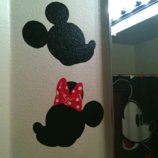 Mickey & Minnie wall paintings by my husband. Painted on our little ones bathroom wall!