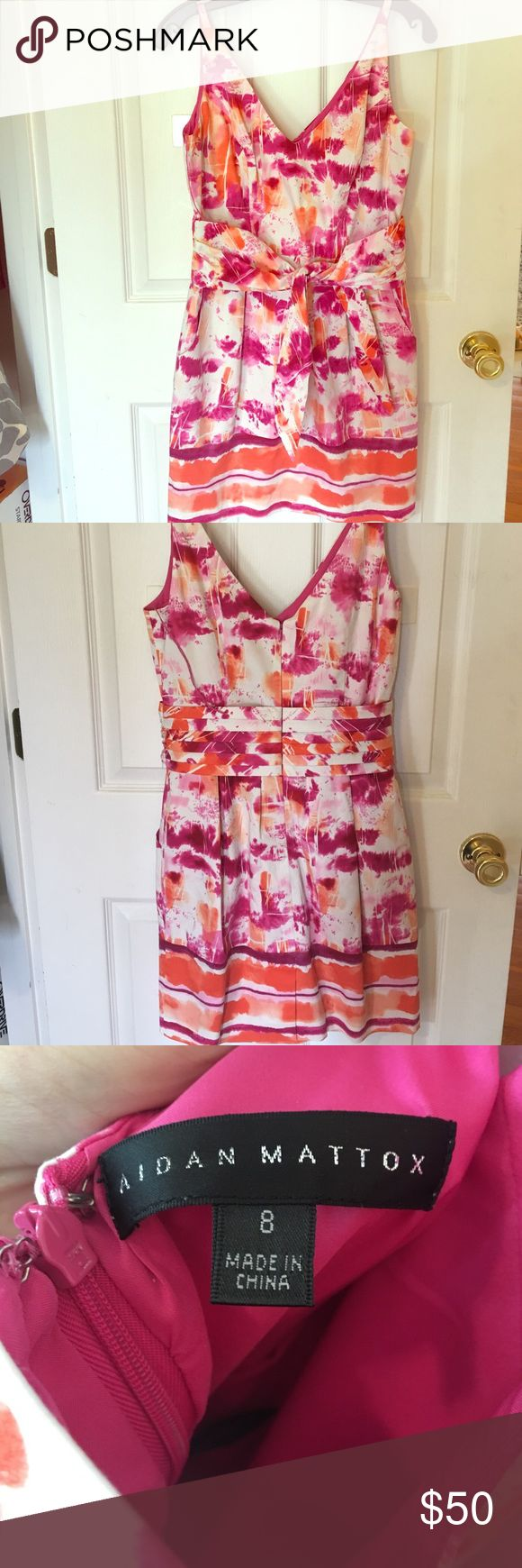Aidan Mattox dress size 8 Authentic Aidan Mattox dress, vibrant colors, the only flaw I see is the sash stitches are sagging a bit, easily fixable but not noticeable when worn. Only worn once. Aidan Mattox Dresses