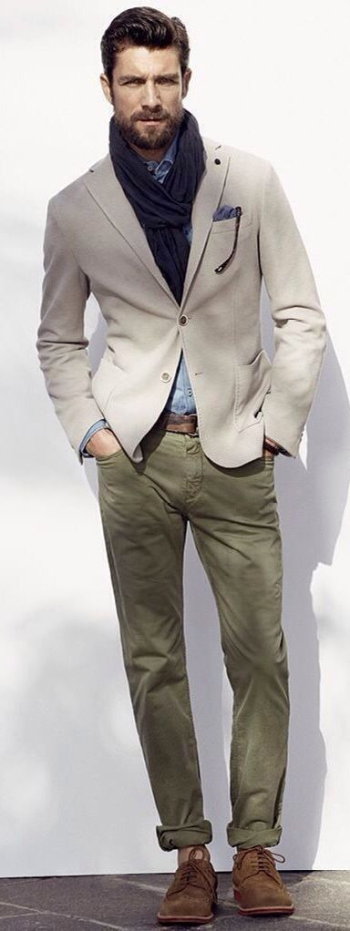 Shop this look on Lookastic:  http://lookastic.com/men/looks/derby-shoes-chinos-belt-long-sleeve-shirt-blazer-scarf/8075  — Brown Suede Derby Shoes  — Olive Chinos  — Dark Brown Leather Belt  — Light Blue Chambray Long Sleeve Shirt  — Beige Blazer  — Navy Scarf