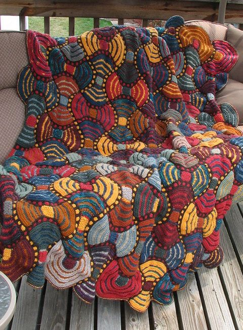 Free Knitting Pattern for African Adventure Afghan - This colorful patchwork quilt is perfect use for scrap yarn. You can make smaller versions to use as table runners and more. Designed by Horst Schulz at South African workshops. Pictured project by hermanm