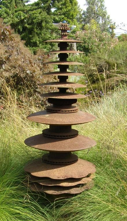 Made from farm discs and tractor parts. Add solar lighting for cool effect