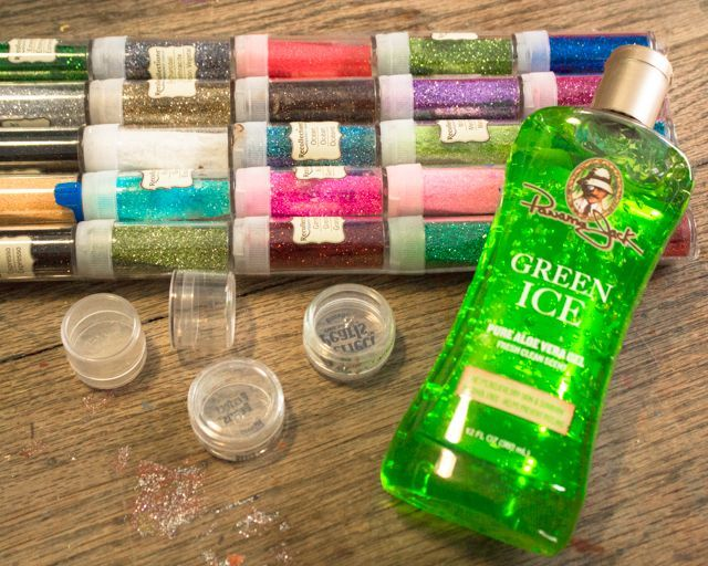 ingredients for DIY body glitter. To make body glitter, you need glitter, small upcycled containers, and aloe vera gel.