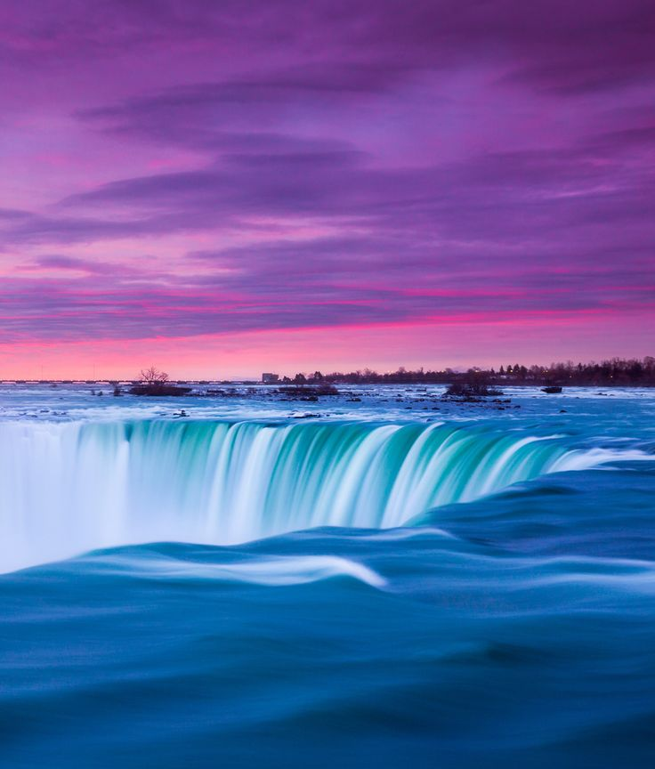 Niagara Falls beneath a pink sunset #GrouponGetaways