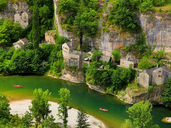 The water-scoured canyons of the Tarn gorge in France's Cevennes National Park draw boaters, hikers, and climbers.  Photograph by Jan Wlodarczyk, Alamy